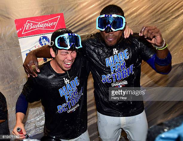 Kenta Maeda and Yasiel Puig of the Los Angeles Dodgers celebrates a 43 win over the Colorado Rockies to clinch the National League West Division at...