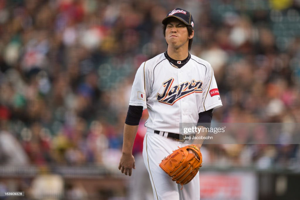 Kenta Maeda #20 of Team Japan reacts to giving up a run in the top of the first inning of the semi-final game against Team Japan in the championship round of the 2013 World Baseball Classic on Sunday, March 17, 2013 at AT&T Park in San Francisco, California.