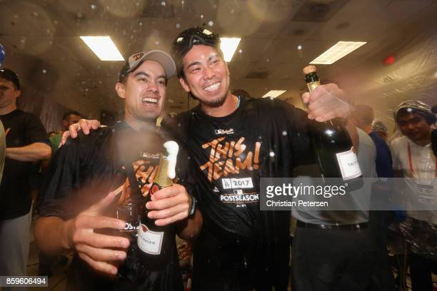 Kenta Maeda of the Los Angeles Dodgers celebrate in the locker room after defeating the Arizona Diamondbacks 31 to win game three of the National...