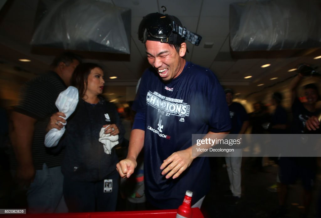Kenta Maeda #18 of the Los Angeles Dodgers celebrates in the clubhouse after their 4-2 win a MLB game against the San Francisco Giants to clinch their fifth consecutive National League West Division title at Dodger Stadium on September 22, 2017 in Los Angeles, California.