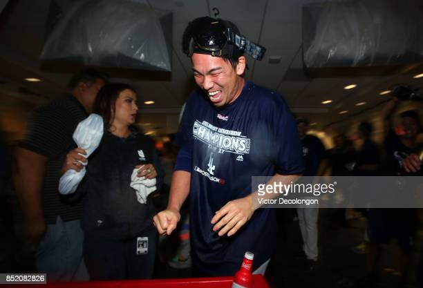 Kenta Maeda of the Los Angeles Dodgers celebrates in the clubhouse after their 42 win a MLB game against the San Francisco Giants to clinch their...