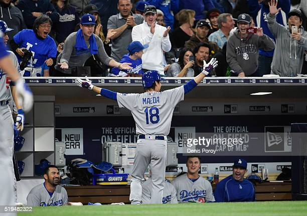 Kenta Maeda of the Los Angeles Dodgers celebrates in the dugout after hitting a solo home run during the foufth inning of a baseball game against the...