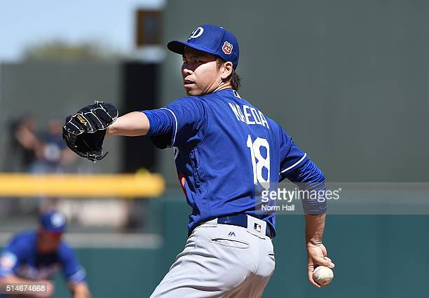 Kenta Maeda of the Los Angeles Dodgers delivers a warm up pitch against the Oakland Athletics at HoHoKam Stadium on March 10 2016 in Mesa Arizona
