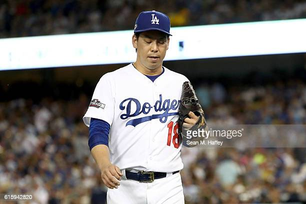 Kenta Maeda of the Los Angeles Dodgers is taken out of the game in the fourth inning against the Chicago Cubs in game five of the National League...
