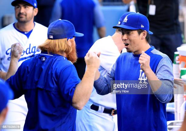 Kenta Maeda of the Los Angeles Dodgers jokes with Justin Turner before the game against the St Louis Cardinals at Dodger Stadium on May 23 2017 in...