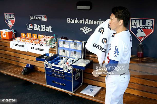 Kenta Maeda of the Los Angeles Dodgers looks on from the dugout against the Chicago Cubs in game five of the National League Division Series at...