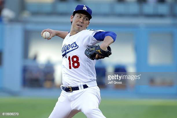 Kenta Maeda of the Los Angeles Dodgers pitches during the first inning against the Chicago Cubs in game five of the National League Division Series...