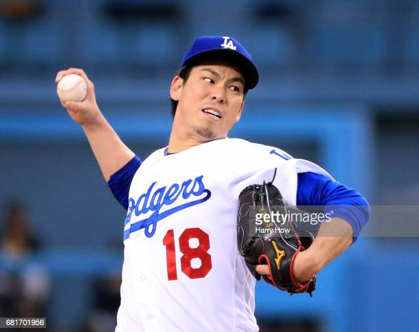 Kenta Maeda of the Los Angeles Dodgers pitches to the Pittsburgh Pirates during the first inning at Dodger Stadium on May 10 2017 in Los Angeles...