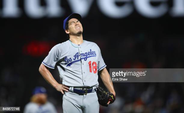 Kenta Maeda of the Los Angeles Dodgers reacts after giving up a home run to Denard Span of the San Francisco Giants in the first inning at ATT Park...