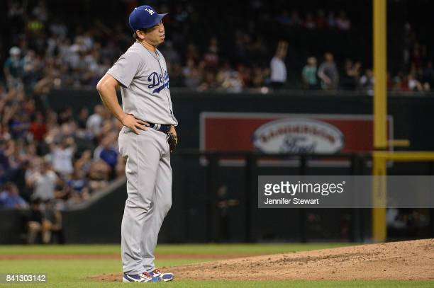 Kenta Maeda of the Los Angeles Dodgers reacts after giving up a two run home run to Chris Iannetta of the Arizona Diamondbacks in the second inning...
