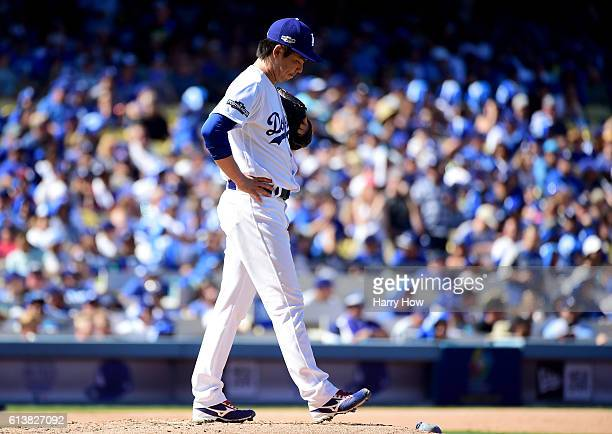 Kenta Maeda of the Los Angeles Dodgers reacts in the third inning against the Washington Nationals in game three of the National League Division...