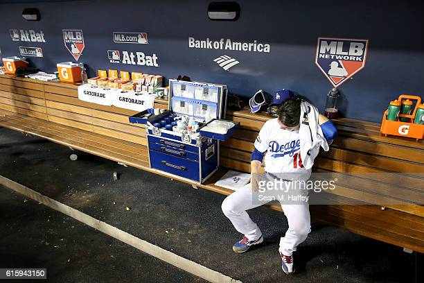 Kenta Maeda of the Los Angeles Dodgers sits in the dugout after being taken out of the game in the fourth inning agianst the Chicago Cubs in game...