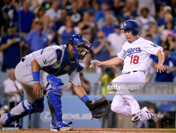 Kenta Maeda of the Los Angeles Dodgers slides to scores past Salvador Perez of the Kansas City Royals from a Corey Seager single to take a 21 lead...