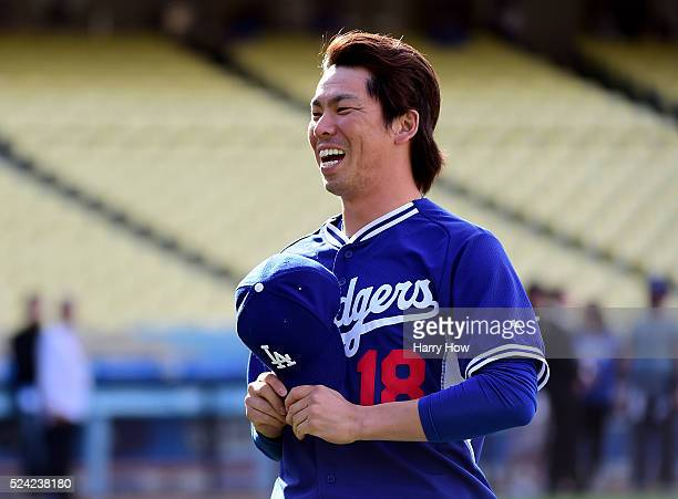 Kenta Maeda of the Los Angeles Dodgers smiles as he walks over to meet Ichiro Suzuki of the Miami Marlins before the game at Dodger Stadium on April...