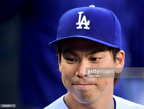 Kenta Maeda of the Los Angeles Dodgers smiles before the game against the the New York Mets at Dodger Stadium on May 11 2016 in Los Angeles California