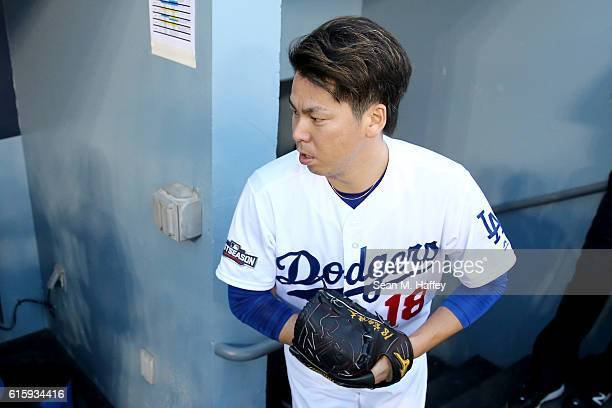 Kenta Maeda of the Los Angeles Dodgers walks to the dugout prior to game five of the National League Division Series at Dodger Stadium on October 20...
