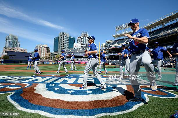 Kenta Maeda of the Los Angeles Dodgers warms up during batting practice before a baseball game against the San Diego Padres on opening day at PETCO...
