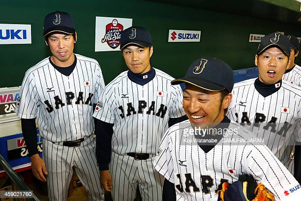 Kenta Maeda Takahiro Norimoto Yuki Nishi and Ryosuke Kikuchi of Samurai Japan pose for photographs after winning the game three of Samurai Japan and...