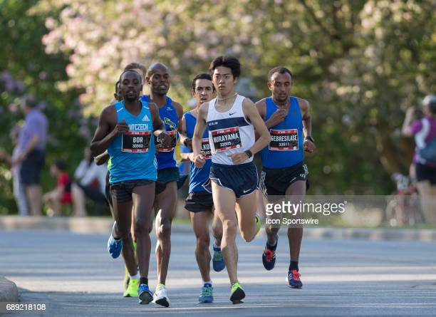Kenta Murayama of Japan takes an early lead over Leul Gebresilase of Ethiopia who won the race and Nicholas Bor of Kenya who finished third They were...