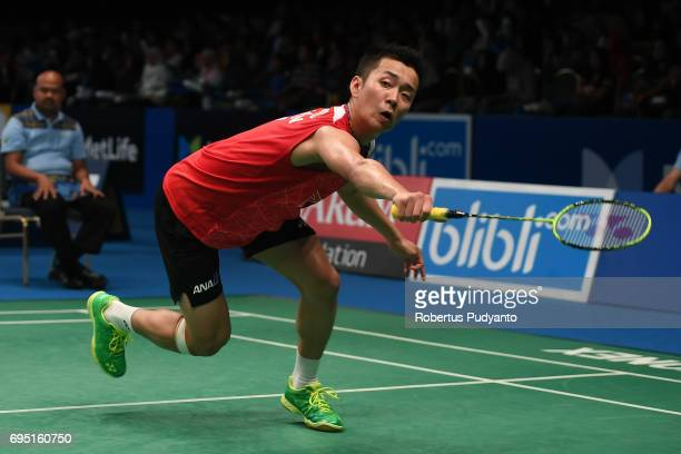Kenta Nishimoto of Japan competes against Takuma Ueda of Japan during Mens single qualification round match of the BCA Indonesia Open Super Series...