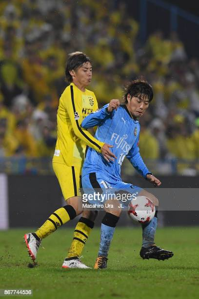 Kentaro Moriya of Kawasaki Frontale controls the ball under pressure of Junya Ito of Kashiwa Reysol during the JLeague J1 match between Kashiwa...