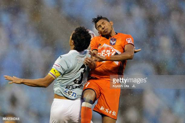 Kentaro Oi of Jubilo Iwata and Rony of Albirex Niigata compete for the ball during the JLeague J1 match between Jubilo Iwata and Albirex Niigata at...