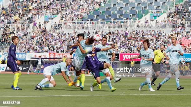 Kentaro Oi of Jubilo Iwata and Yuki Nogami of Sanfrecce Hiroshima compete for the ball during the JLeague J1 match between Sanfrecce Hiroshima and...