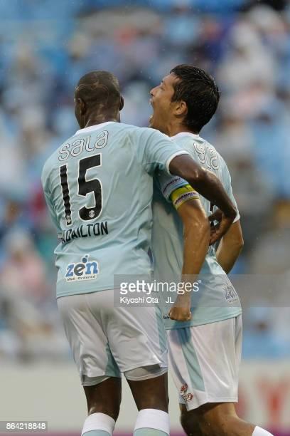 Kentaro Oi of Jubilo Iwata celebrates scoring his side's first goal with his team mate Adailton during the JLeague J1 match between Jubilo Iwata and...