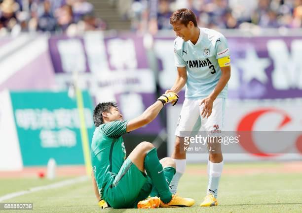 Kentaro Oi of Jubilo Iwata helps Takuto Hayashi of Sanfrecce Hiroshima standing up during the JLeague J1 match between Sanfrecce Hiroshima and Jubilo...