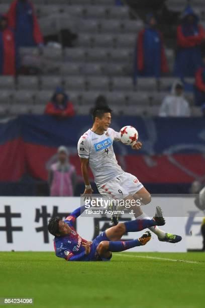 Kentaro Oi of Jubilo Iwata is tackled by Yoshito Okubo of FC Tokyo during the JLeague J1 match between FC Tokyo and Consadole Sapporo at Ajinomoto...