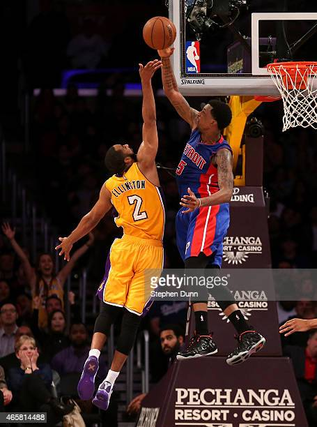Kentavios CaldwellPope of the Detroit Pistons blocks a shot by Wayne Ellington of the Los Angeles Lakers at Staples Center on March 10 2015 in Los...