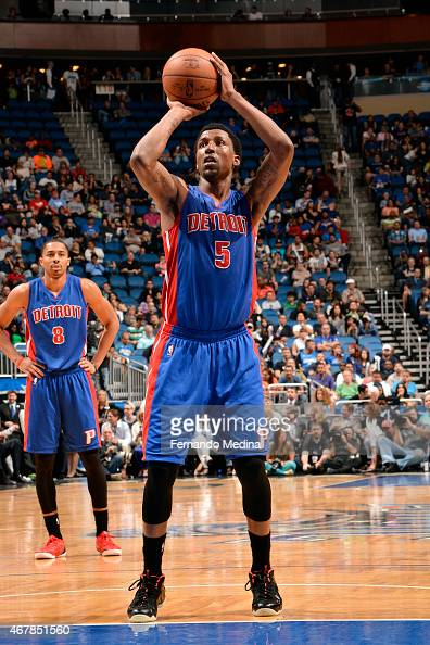 Kentavious CaldwellPope of the Detroit Pistons attempts a free throw against the Orlando Magic on March 27 2015 at Amway Center in Orlando Florida...