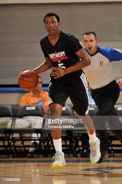 Kentavious CaldwellPope of the Detroit Pistons brings up the ball against the Miami Heat during the 2013 Southwest Airlines Orlando Pro Summer League...