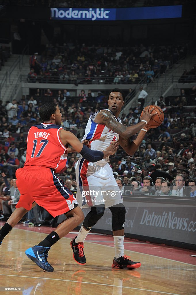 Kentavious CaldwellPope of the Detroit Pistons controls the ball against Garrett Temple of the Washington Wizards during the game on October 30 2013...