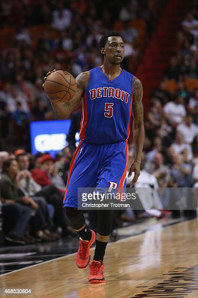 Kentavious CaldwellPope of the Detroit Pistons dribbles the ball against the Miami Heat at American Airlines Arena on March 29 2015 in Miami Florida...
