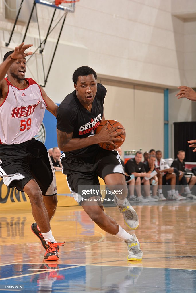 Kentavious Caldwell-Pope #5 of the Detroit Pistons drives against Ian Clark #59 of the Miami Heat during the 2013 Southwest Airlines Orlando Pro Summer League on July 12, 2013 at Amway Center in Orlando, Florida.