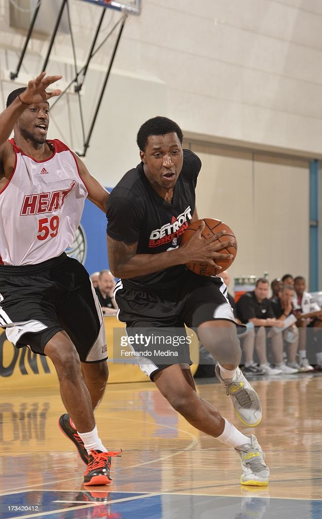 Kentavious Caldwell-Pope #5 of the Detroit Pistons drives against Ian Clark #59 of the Miami Heat during the 2013 Southwest Airlines Orlando Pro Summer League between the Detroit Pistons and the Miami Heat on July 12, 2013 at Amway Center in Orlando, Florida.