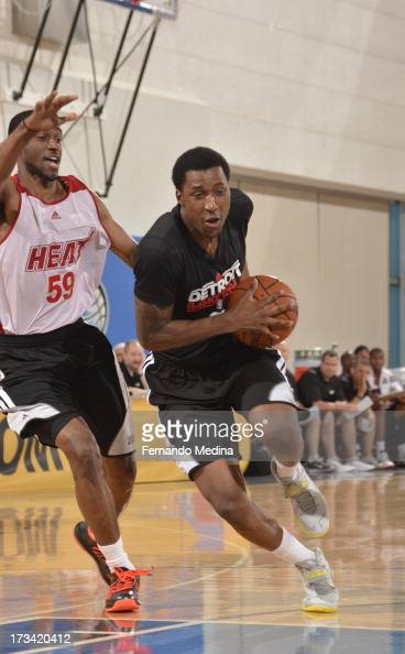Kentavious CaldwellPope of the Detroit Pistons drives against Ian Clark of the Miami Heat during the 2013 Southwest Airlines Orlando Pro Summer...