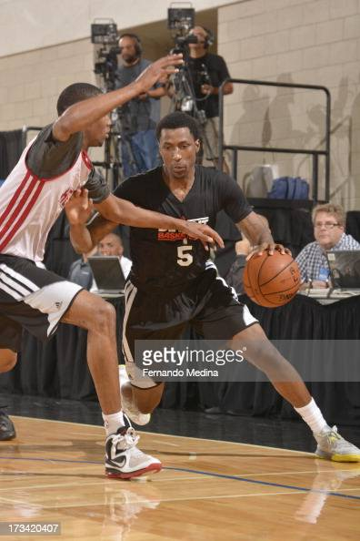 Kentavious CaldwellPope of the Detroit Pistons drives under pressure during the 2013 Southwest Airlines Orlando Pro Summer League between the Detroit...