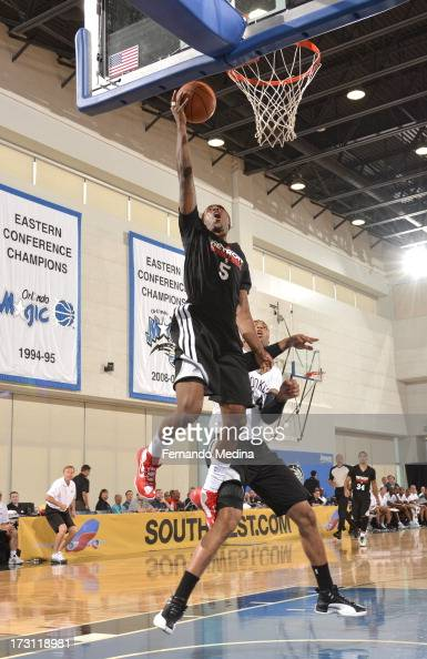 Kentavious CaldwellPope of the Detroit Pistons goes to the basket during the 2013 Southwest Airlines Orlando Pro Summer League game between the...