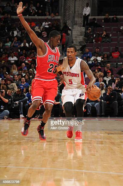 Kentavious CaldwellPope of the Detroit Pistons handles the ball against Tony Snell of the Chicago Bulls during the game on October 7 2014 at The...