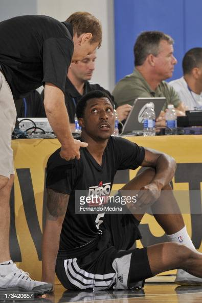 Kentavious CaldwellPope of the Detroit Pistons listens to instructions during the 2013 Southwest Airlines Orlando Pro Summer League between the...