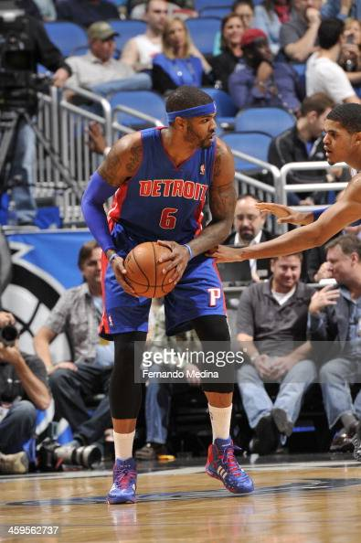 Kentavious CaldwellPope of the Detroit Pistons looks to pass the ball against the Orlando Magic during the game on December 27 2013 at Amway Center...