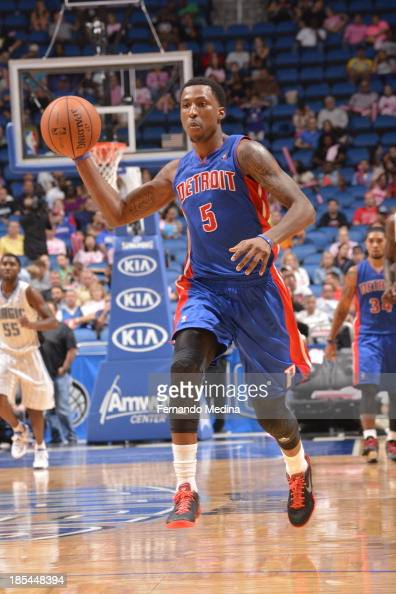 Kentavious CaldwellPope of the Detroit Pistons passes the ball against the Orlando Magic during the game on October 20 2013 at Amway Center in...