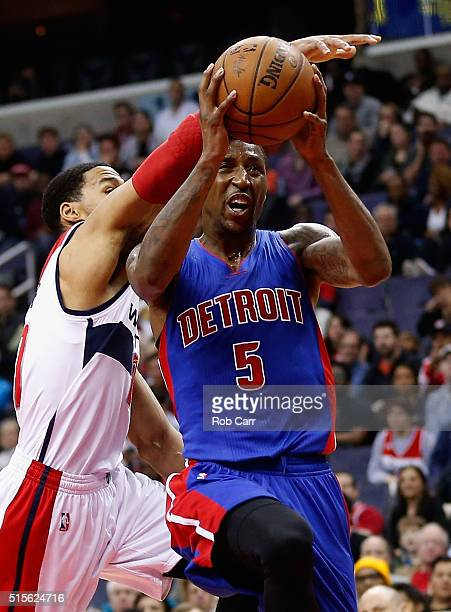 Kentavious CaldwellPope of the Detroit Pistons puts up a shot in front of Ramon Sessions of the Washington Wizards in the first half at Verizon...