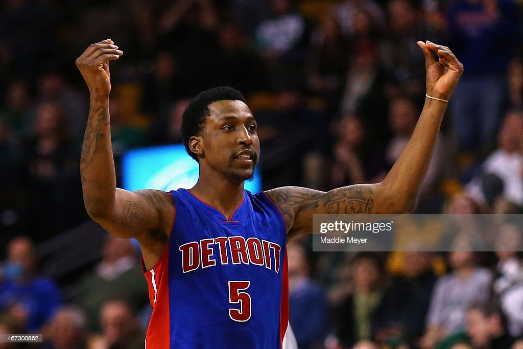 Kentavious CaldwellPope of the Detroit Pistons reacts after scoring a three point basket during overtime against the Boston Celtics at TD Garden on...