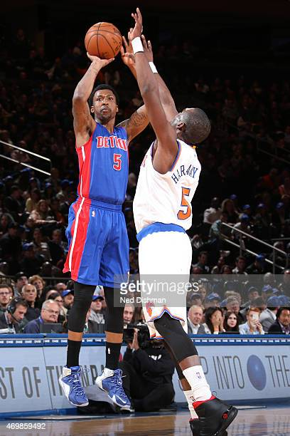 Kentavious CaldwellPope of the Detroit Pistons shoots against Tim Hardaway Jr #5 of the New York Knicks on April 15 2015 at Madison Square Garden in...