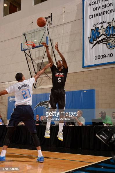 Kentavious CaldwellPope of the Detroit Pistons shoots the ball against Andre Roberson of the Oklahoma City Thunder during the 2013 Southwest Airlines...