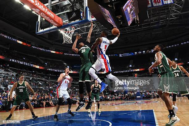 Kentavious CaldwellPope of the Detroit Pistons shoots the ball against John Henson of the Milwaukee Bucks on October 17 2016 at The Palace of Auburn...
