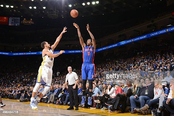 Kentavious CaldwellPope of the Detroit Pistons shoots the ball against Stephen Curry of the Golden State Warriors on November 9 2015 at ORACLE Arena...